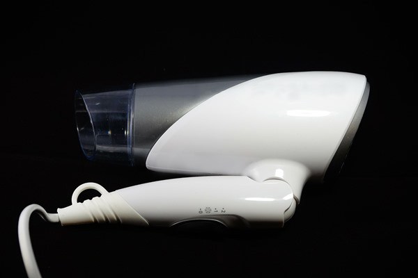 White hair dryer with folded handle