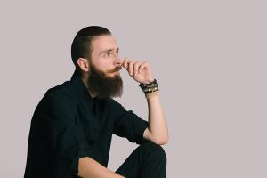 Using men's hair products for styling hair and beard.