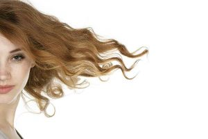 Woman flipping her shiny, smooth, and strong hair