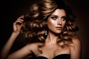 Beautiful woman with thick golden brown hair