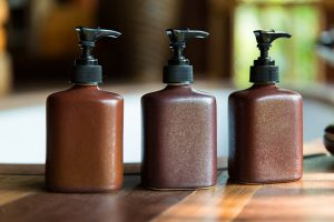 Bottles of argan oil-infused hair care products
