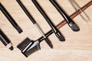 Tools for applying castor oil to eyebrows