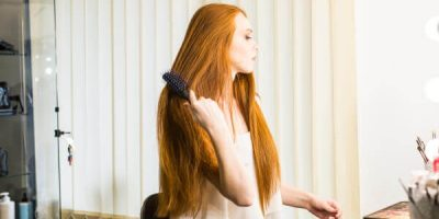 Woman brushing her long and shiny hair