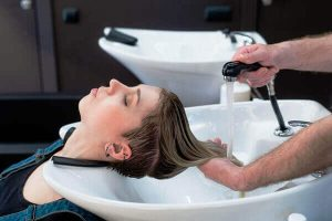 Cleansing girl's hair with dandruff shampoo